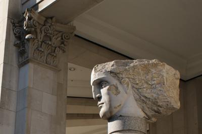 Sculpture of a head & pillar capital