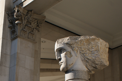 Sculpture of a head & pillar capital